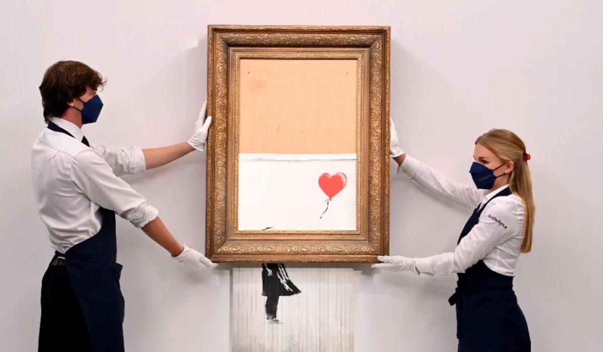 Obra autodestruida de Banksy es subastada en 25.4 mdd
